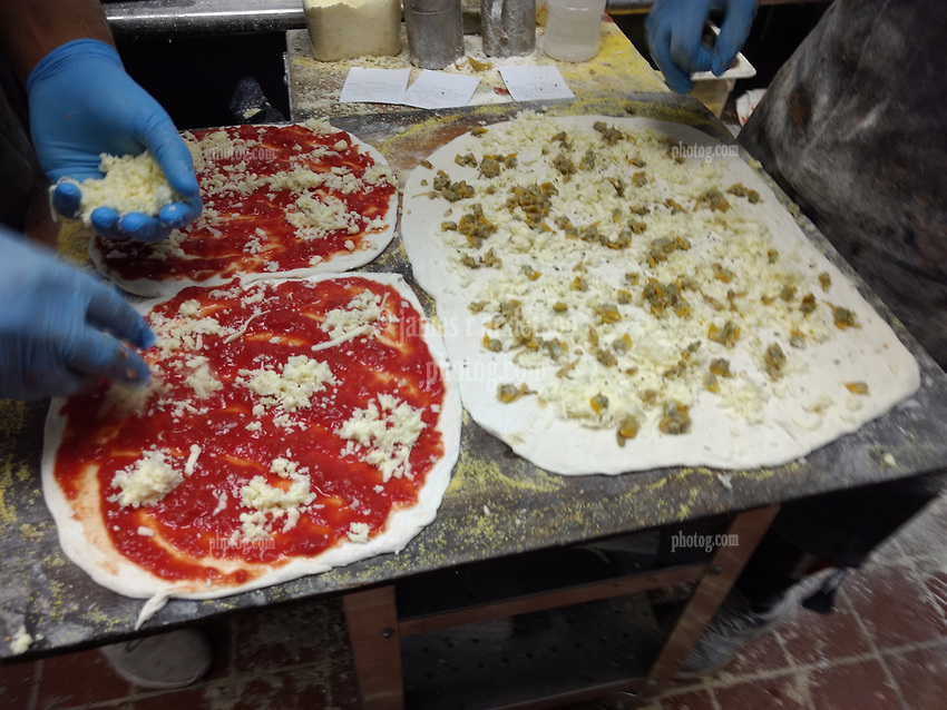 Sally's Apizza Restaurant preparring pies in the Kitchen - New Haven CT 2 June 2019
