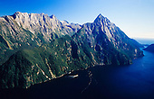 An aerial view looking over Milford Sound to Mitre Peak. The Llawrenny Peaks are in the distance to the left, Fiordland National Park, South Island, New Zealand.