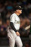 Norfolk Tides manager Ron Johnson (4) walks back to the dugout during a game against the Buffalo Bisons on July 18, 2016 at Coca-Cola Field in Buffalo, New York.  Norfolk defeated Buffalo 11-8.  (Mike Janes/Four Seam Images)