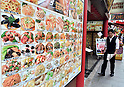 July 24th,2011 - Yokohama, Japan - An employee working at a Chinese restaurant promotes his business to attract customers in Yokohama's Chinatown district. Yokohama Chinatown is a largest Chinatown in Asia with a history that dates back to approximately 150 years. Until today, it still remains as a popular tourist destination for locals and travelers abroad. (Photo by Yumeto Yamazaki/AFLO)