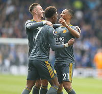 Leicester City's Youri Tielemans celebrates scoring the opening goal with team-mates Demarai Gray and James Maddison <br /> <br /> Photographer Stephen White/CameraSport<br /> <br /> The Premier League - Huddersfield Town v Leicester City - Saturday 6th April 2019 - John Smith's Stadium - Huddersfield<br /> <br /> World Copyright © 2019 CameraSport. All rights reserved. 43 Linden Ave. Countesthorpe. Leicester. England. LE8 5PG - Tel: +44 (0) 116 277 4147 - admin@camerasport.com - www.camerasport.com