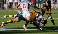 February 14 2009, San Diego, CA, USA:  The IRB USA Sevens Tournament at Petco Park in Downtown San Diego.  US player Kevin Swiryn is tackled by Australian player Jonathan Jenkins during day one action.  The US went on to defeat Australia 17 -12.