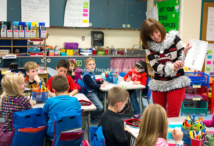 Middlebury, CT- 23 December 2015-122315CM03-  Long Meadow Elementary School first grade teacher, Jami Richardson talks to her students at the school on Wednesday.  The district's Ugly Sweater Contest was held an event  that raises money for the Victoria Soto Memorial fund, named after the teacher who gave up her life to save children during the shooting at Sandy Hook Elementary School.   Christopher Massa Republican-American
