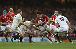 Toby Faletau takes on the English defence..2013 RBS 6 Nations Championship.Wales v England.Millennium Stadium.16.03.13.Credit: Steve Pope- Sportingwales