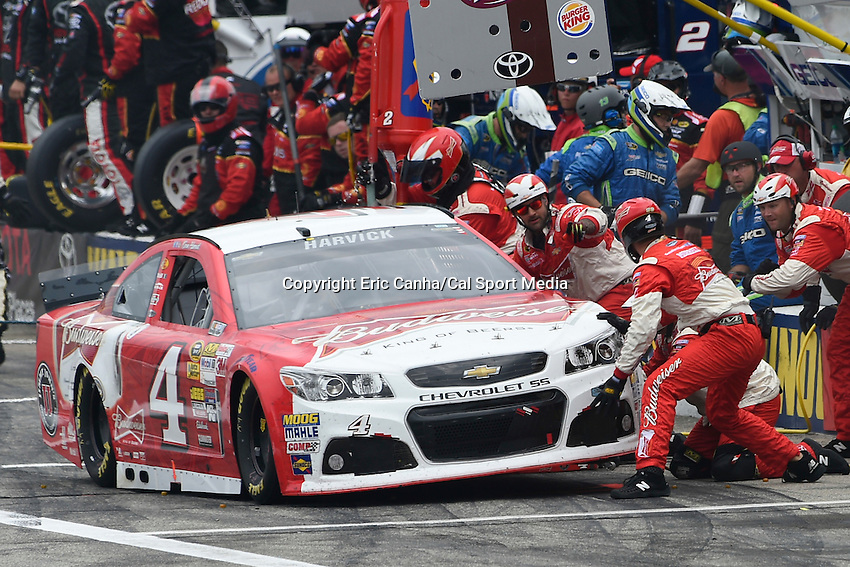 July 13, 2014 - Loudon, New Hampshire, U.S. - Sprint Cup Series driver Kevin Harvick (4) takes a pit stop during the NASCAR Sprint Cup Series Camping World RV 301 race held at the New Hampshire Motor Speedway in Loudon, New Hampshire. Eric Canha/CSM