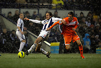 Pictured: Gylfi Sigurdsson of Swansea (R) challenging Jonas Olsson of West Bromwich (L). Saturday, 04 February 2012<br />