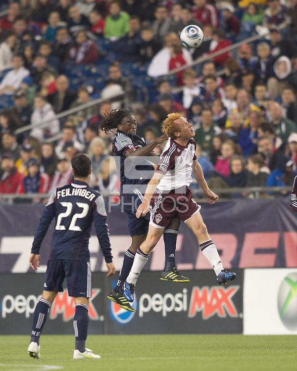 New England Revolution midfielder Shalrie Joseph (21) and Colorado Rapids midfielder Jeff Larentowicz (4) battle for head ball. In a Major League Soccer (MLS) match, the New England Revolution tied the Colorado Rapids, 0-0, at Gillette Stadium on May 7, 2011.