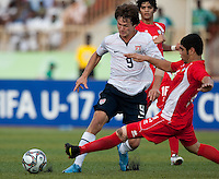 Jack McInerney tries to avoid the tackle. US Under-17 Men's National Team defeated United Arab Emirates 1-0 at Gateway International  Stadium in Ijebu-Ode, Nigeria on November 1, 2009.