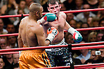 New York, Nov. 10th, 2008: Joe Calzaghe (black trunk) on the attack against  Roy Jones Jr. during their Ring Magazine Light Heavyweight Championship fight at  Madison Square Garden. Calzaghe won by unanimous decision. Photo by Thierry Gourjon.