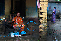 Nomita Biswas (32), is working on a charkha. She is a weaver of fine handloom sarees, She expanded her business by taking micro credits from Bandhan. She earns about 400 usd/ month. Shantipur, West Bengal, India. Arindam Mukherjee