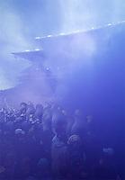 Husky Stadium is enveloped in a purple haze.