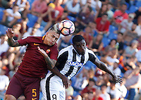 Calcio, Serie A: Roma vs Udinese. Roma, stadio Olimpico, 20 agosto 2016.<br /> Roma&rsquo;s Leandro Paredes, left, and Udinese&rsquo;s Duvan Zapata jump for the ball during the Italian Serie A football match between Roma and Udinese at Rome's Olympic Stadium, 20 August 2016. Roma won 4-0.<br /> UPDATE IMAGES PRESS/Riccardo De Luca