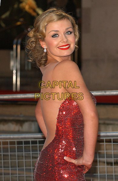 KATHERINE JENKINS.The 2006 Brit Awards with Mastercard at Earls Court, London, UK..February 15th 2006.Ref: BEL.brits half length red sequin strapless sheer dress hands on hips backless.www.capitalpictures.com.sales@capitalpictures.com.© Capital Pictures.