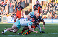 Picture by Allan McKenzie/SWpix.com - 11/02/2018 - Rugby League - Betfred Super League - Castleford Tigers v Widnes Vikings - the Mend A Hose Jungle, Castleford, England - Castleford's Jake Webster is tackled by Widnes's Matt Whitley & Joe Mellor.