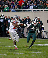 Ohio State Buckeyes running back Ezekiel Elliott (15) scores a rushing touchdown against \Michigan State Spartans cornerback Trae Waynes (15) during the 4th quarter at Spartan Stadium in East Lansing, Michigan on November 8, 2014.  (Dispatch photo by Kyle Robertson)