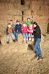 Families gather after Christmas at the Cuneo Ranch in California's Mother Lode. Mandy with the kids in the barn.