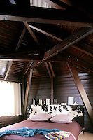 The chalet's master bedroom has a headboard upholstered in cow hide