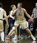SIOUX FALLS, SD - MARCH 9:  Sam Vander Sluis #42 of Cornerstone dribbles into Southwestern defender Troy Baker #23 at the 2018 NAIA DII Men's Basketball Championship at the Sanford Pentagon in Sioux Falls. (Photo by Dick Carlson/Inertia)