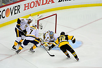 May 29, 2017: Nashville Predators goalie Pekka Rinne (35) covers the puck before Pittsburgh Penguins right wing Patric Hornqvist (72) can get to it during game one of the National Hockey League Stanley Cup Finals between the Nashville Predators  and the Pittsburgh Penguins, held at PPG Paints Arena, in Pittsburgh, PA. Pittsburgh defeats Nashville 5-3 in regulation time.  Eric Canha/CSM