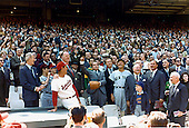 Washington, D.C. - April 8, 1969 -- United States President Richard M. Nixon throws out the first ball on opening day, April 8, 1969, at RFK Stadium in Washington, DC.  Washington Senators manager Ted Williams (wearing Senators uniform), Baseball commmissioner Bowie Kuhn (with hand on Williams' shoulder), Senators owner Bob Short and Yankee manager Ralph Houk (in Yankees uniform) are in the center of the photo..Credit: White House via CNP