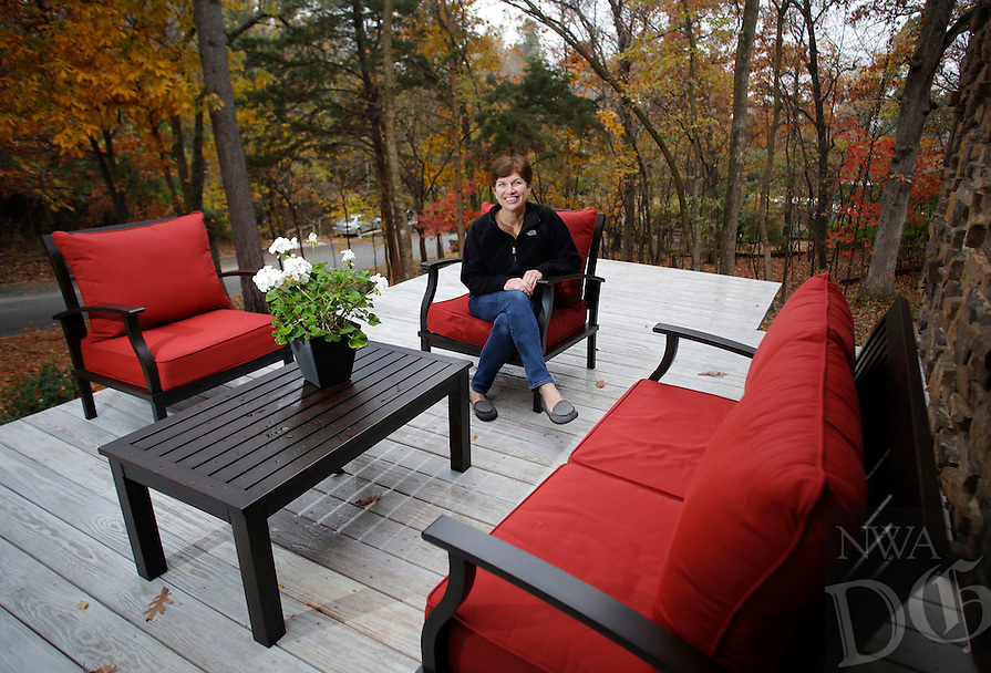 NWA Democrat-Gazette/DAVID GOTTSCHALK  Laurie Malloy sits Wednesday, November 23, 2016, in her favorite personal space, the front deck of her home in Fayetteville.