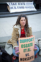 Activists gather in Foley Square in New York on Tuesday, January 31, 2012 to support OSGATA farmers in their litigation against Monsanto to protect their crops from genetic trespass by the chemical company's genetically modified seeds.  (© Frances M. Roberts)