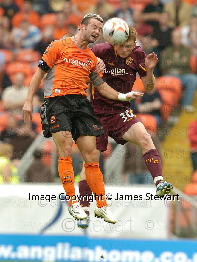 23/09/2006       Copyright Pic: James Stewart.File Name :sct_jspa04_dundee_utd_v_motherwell.NOEL HUNT AND MARK REYNOLDS CHALLENGE FOR THE BALL....Payments to :.James Stewart Photo Agency 19 Carronlea Drive, Falkirk. FK2 8DN      Vat Reg No. 607 6932 25.Office     : +44 (0)1324 570906     .Mobile   : +44 (0)7721 416997.Fax         : +44 (0)1324 570906.E-mail  :  jim@jspa.co.uk.If you require further information then contact Jim Stewart on any of the numbers above.........