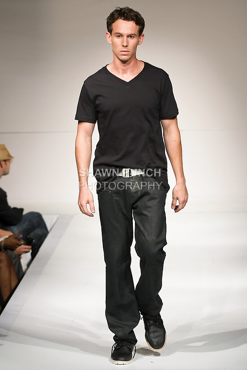 Model walks the runway in an outfit by Paul Aarington, for the Paul Aarrington Denim Studio Spring 2011 fashion show, during Nolcha Fashion Week, September 14, 2010.