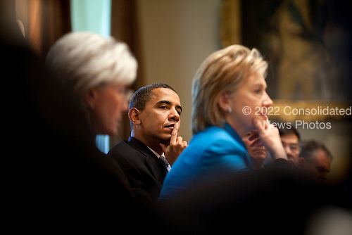 Washington, DC - May 1, 2009 -- United States President Barack Obama, center, holds a Homeland Security Council meeting to discuss H1N1 flu in the Cabinet Room, Friday,  May 1, 2009, including Secretary of Health and Human Services, Kathleen Sebelius, left,and Secretary of State Hillary Rodham Clinton, right..Mandatory Credit: Pete Souza - White House via CNP