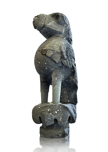 A Colossal statue of a Bird of Prey excavated in the forecourt of a temple palace at Tell Halaf, Syria. Originally the bird statue had coloured stones in its eye socket and was mounted as part of a decorative column. Basalt 9th century BC. Pergamon Museum, Berlin.