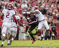 Hawgs Illustrated/BEN GOFF <br /> Henre' Toliver, Arkansas cornerback, tackles South Carolina wide receiver OrTre Smith as he catches a pass in the first half Saturday, Oct. 7, 2017, at Williams-Brice Stadium in Columbia, S.C.