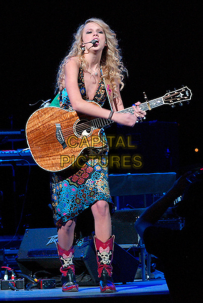 TAYLOR SWIFT.Country music entertainer TAYLOR SWIFT performs as opening act for George Strait's 2007 Tour held at the Mellon Arena, Pittsburgh, Pennsylvania, USA,.16 February 2007..full length guitar concert on stage skull cowboy boots.CAP/ADM/JN.©Jason L Nelson/AdMedia/Capital Pictures.