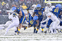 PHILADELPHIA, PA - DEC 9, 2017: Navy Midshipmen running back Malcolm Perry (10) goes air born through the hole during game between Army and Navy at Lincoln Financial Field Philadelphia, PA. Army defeated Navy 14-13 to win the Commander in Chief Cup. (Photo by Phil Peters/Media Images International)