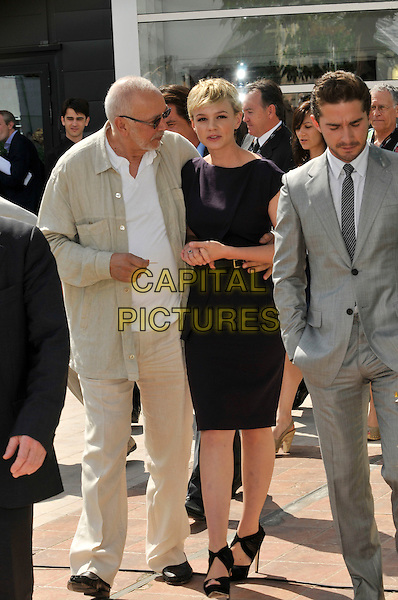 FRANK LANGELLA, CAREY MULLIGAN & SHIA LABOEUF.The 'Wall Street: Money Never Sleeps' Photo Call held at the Palais des Festivals during the 63rd Annual International Cannes Film Festival, Cannes, France. .May 14th, 2010.full length black navy blue dress peplum sandals sleeveless open toe sunglasses shades walking sunglasses shades beige la beouf .CAP/PL.©Phil Loftus/Capital Pictures.