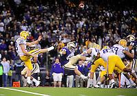 Sept. 5, 2009; Seattle, WA, USA; LSU Tigers punter (38) Derek Helton punts the ball as Washington Huskies linebacker (43) T.J. Poe attempts to block the kick at Husky Stadium. LSU defeated Washington 31-23. Mandatory Credit: Mark J. Rebilas-
