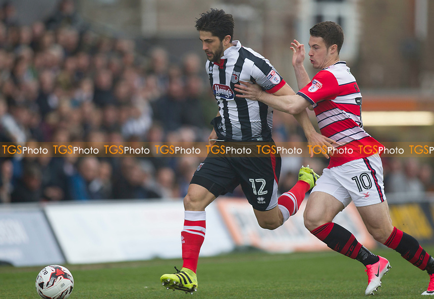 Zak Mills of Grimsby T strides out during Grimsby Town vs Doncaster Rovers, Sky Bet EFL League 2 Football at Blundell Park on 1st April 2017
