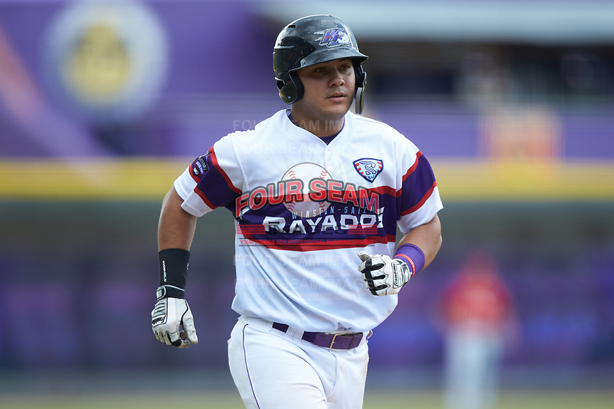 Daniel Gonzalez (17) of the Winston-Salem Rayados jogs towards home plat after hitting a home run against the Potomac Nationals at BB&T Ballpark on August 12, 2018 in Winston-Salem, North Carolina. The Rayados defeated the Nationals 6-3. (Brian Westerholt/Four Seam Images)