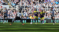 Pictured: Wayne Routledge of Swansea (3rd L) against Cheik Tiote of Newcastle (4). Saturday 19 April 2014<br /> Re: Barclay's Premier League, Newcastle United v Swansea City FC at St James Park, Newcastle, UK.