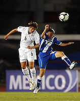 Amy LePelibet of USA (L) at the 2010 CONCACAF Women's World Cup Qualifying tournament held at Estadio Quintana Roo in Cancun, Mexico.