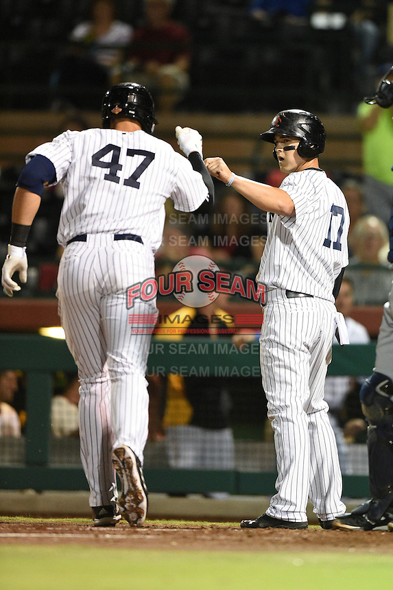 Scottsdale Scorpions outfielder Tyler Austin (17) greets Aaron Judge (47) after a home run during an Arizona Fall League game against the Surprise Saguaros on October 15, 2014 at Scottsdale Stadium in Scottsdale, Arizona.  Surprise defeated Scottsdale 13-11.  (Mike Janes/Four Seam Images)