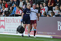 Erin Simon of West Ham leaves the field with an injury during Arsenal Women vs West Ham United Women, Barclays FA Women's Super League Football at Meadow Park on 8th September 2019