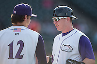 Winston-Salem Dash catcher Zack Collins (right) chats with starting pitcher Spencer Adams (12) prior to the game against the Potomac Nationals at BB&T Ballpark on July 15, 2016 in Winston-Salem, North Carolina.  (Brian Westerholt/Four Seam Images)