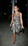 March 27th 2012..Kim Kardashian wearing a white black zebra print dress arriving at Mr.Chow restaurant in Beverly HIlls solo ..AbilityFilms@yahoo.com.805-427-3519.www.AbilityFilms.com.