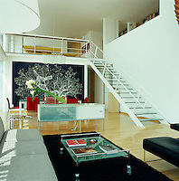 A mural by Pablo Vargas Lugo dominates the dining area end of the open plan living room