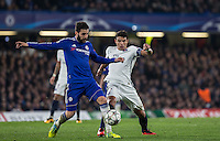 Cesc Fabregas of Chelsea & Thiago Silva of Paris Saint-Germain battle during the UEFA Champions League Round of 16 2nd leg match between Chelsea and PSG at Stamford Bridge, London, England on 9 March 2016. Photo by Andy Rowland.