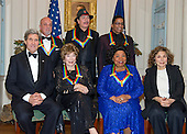 The five recipients of the 2013 Kennedy Center Honors pose for a group photo following a dinner hosted by United States Secretary of State John F. Kerry at the U.S. Department of State in Washington, D.C. on Saturday, December 1, 2013.  The 2013 honorees are opera singer Martina Arroyo; pianist, keyboardist, bandleader and composer Herbie Hancock; pianist, singer and songwriter Billy Joel; actress Shirley MacLaine; and musician and songwriter Carlos Santana.  Seated in the front row are: U.S. Secretary of State John Kerry, Shirley MacLain, Martina Arroyo, and Teresa Heinz Kerry. Standing are Billy Joel, Carlos Santana, and Herbie Hancock.<br /> Credit: Ron Sachs / CNP
