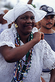 Salvador, Bahia, Brazil. Woman Candomble follower dressed in traditional white lace with beads; Festival of Iemanja.