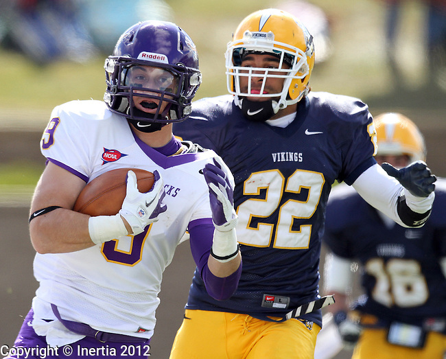 SIOUX FALLS, SD - OCTOBER 6: Adam Thielen #9 from Minnesota State Mankato is brought down from behind by Anthony Tucker #22 from Augustana in the second quarter Saturday afternoon at Augustana. (Photo by Dave Eggen/Inertia)