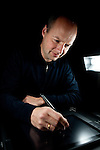 Udacity co-founder Professor Sebastian Thrun writes lecture notes on a tablet in their Palo Alto, Calif. office, February 24, 2012.