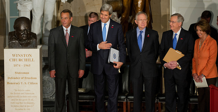 UNITED STATES - Oct 30: The U.S. Congress holds a ceremony to dedicate a bust of the late Prime Minister of the United Kingdom Winston Churchill, who became an honorary U.S. citizen in 1963. Speaker of the House John Boehner, R-OH., Secretary of State John Kerry, Senators Harry Reid, Mitch McConnell and Rep. Nancy Pelosi watch the presentation of colors by the United States Armed Forces Color Guard on October 30, 2013. (Photo By Douglas Graham/CQ Roll Call)